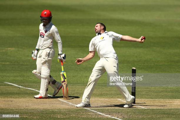 Jon Holland of the Bushrangers bowls during the Sheffield Shield final between Victoria and South Australia on March 28 2017 in Alice Springs...