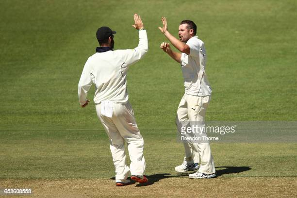 Jon Holland of the Bushrangers celebrates after claiming the wicket of Joe Mennie of the Redbacks during the Sheffield Shield final between Victoria...