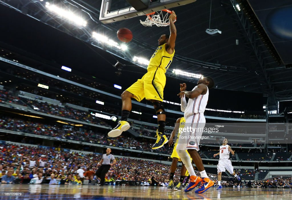 Jon Horford #15 of the Michigan Wolverines dunks against the Florida Gators iin the second half during the South Regional Round Final of the 2013 NCAA Men's Basketball Tournament at Dallas Cowboys Stadium on March 31, 2013 in Arlington, Texas.