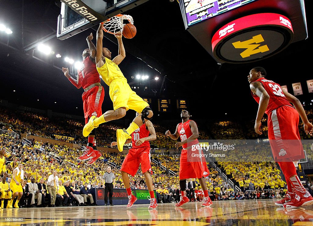 Jon Horford #15 of the Michigan Wolverines dunks in the first half in front of Deshaun Thomas #1 of the Ohio State Buckeyesat Crisler Center on February 5, 2013 in Ann Arbor, Michigan. Michigan won the game 76-74 in overtime.
