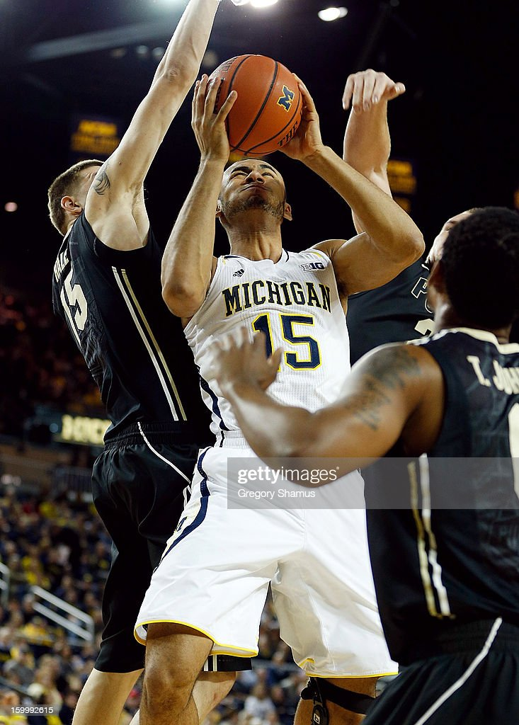 Jon Horford #15 of the Michigan Wolverines gets a shot off against Donnie Hale #15 of the Purdue Boilermakers during the first half at Crisler Center on January 24, 2013 in Ann Arbor, Michigan.