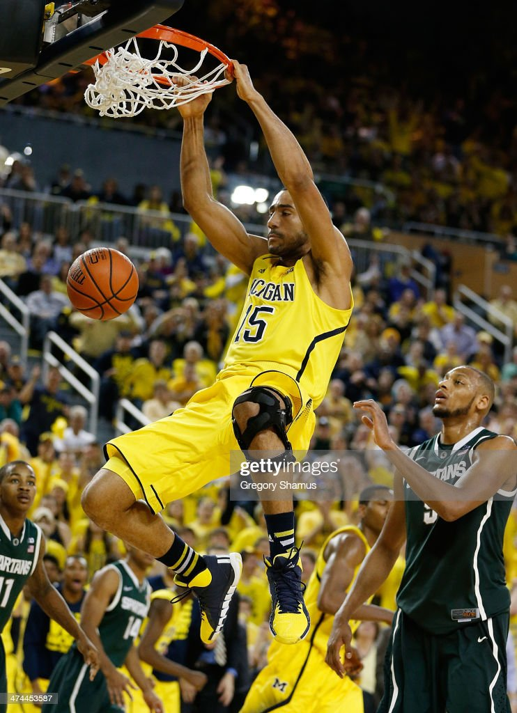 Jon Horford #15 of the Michigan Wolverines gets in for a second half dunk in front of <a gi-track='captionPersonalityLinkClicked' href=/galleries/search?phrase=Adreian+Payne&family=editorial&specificpeople=7367769 ng-click='$event.stopPropagation()'>Adreian Payne</a> #5 of the Michigan State Spartans at Crisler Center on February 23, 2014 in Ann Arbor, Michigan. Michigan won the game 79-70.
