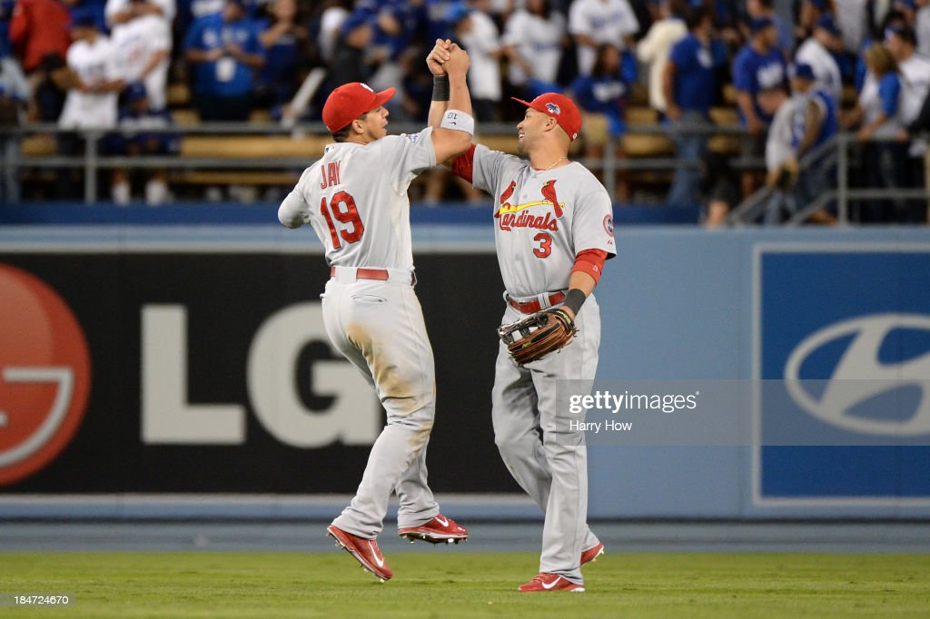 <a gi-track='captionPersonalityLinkClicked' href=/galleries/search?phrase=Jon+Jay+-+Baseball+Player&family=editorial&specificpeople=5734285 ng-click='$event.stopPropagation()'>Jon Jay</a> #19 and <a gi-track='captionPersonalityLinkClicked' href=/galleries/search?phrase=Carlos+Beltran&family=editorial&specificpeople=167108 ng-click='$event.stopPropagation()'>Carlos Beltran</a> #3 of the St. Louis Cardinals celebrate the 4-2 victory against the Los Angeles Dodgers in Game Four of the National League Championship Series at Dodger Stadium on October 15, 2013 in Los Angeles, California.