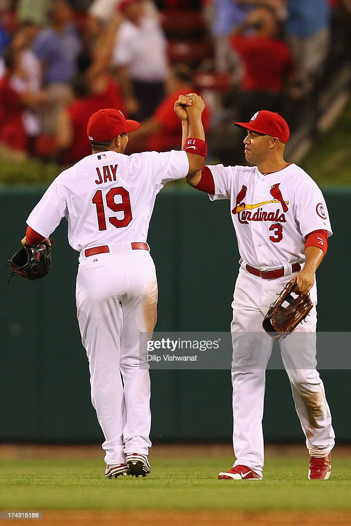 Jon Jay #19 and Carlos Beltran #3 of the St. Louis Cardinals celebrate beating the Philadelphia Phillies at Busch Stadium on July 23, 2013 in St. Louis, Missouri. The Cardinals beat the Phillies 4-1.