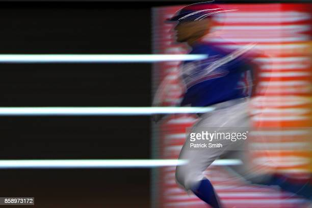 Jon Jay of the Chicago Cubs doubles against the Washington Nationals in game one of the National League Division Series at Nationals Park on October...