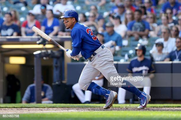 Jon Jay of the Chicago Cubs hits a single in the tenth inning against the Milwaukee Brewers at Miller Park on September 23 2017 in Milwaukee Wisconsin