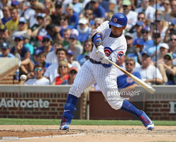Jon Jay of the Chicago Cubs hits a three run pinch hit home run to tie the game against the Tampa Bay Rays in the 6th inning at Wrigley Field on July...