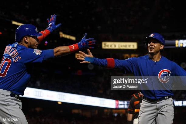 Jon Jay of the Chicago Cubs is congratulated by Willson Contreras after scoring a run against the San Francisco Giants during the fifth inning at ATT...