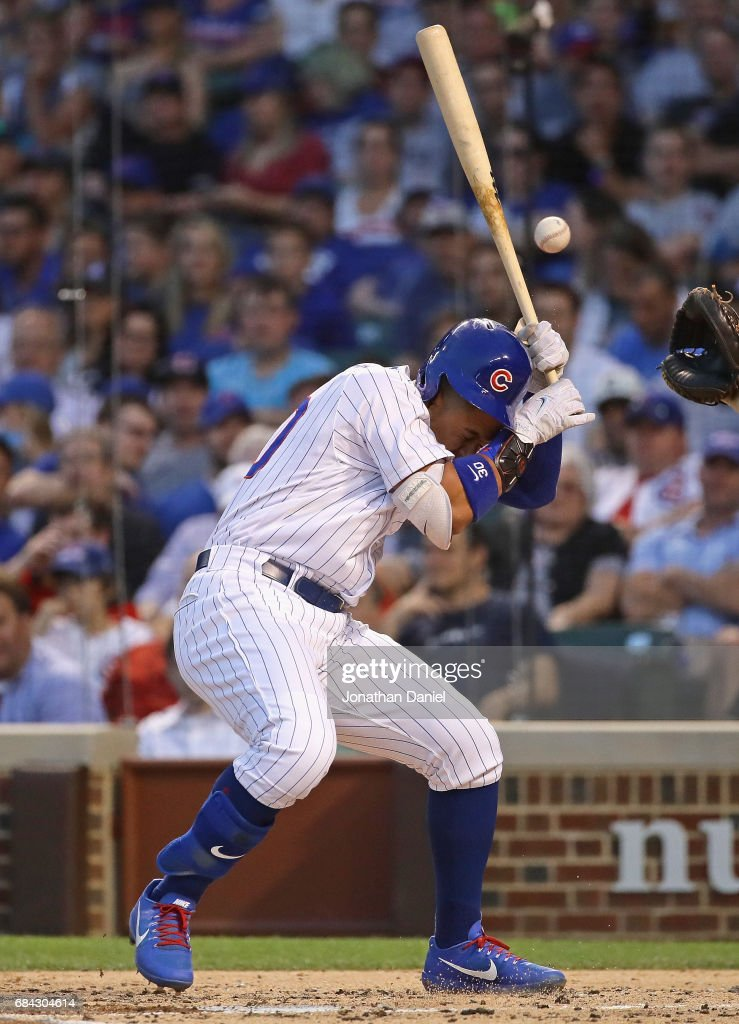 Jon Jay #30 of the Chicago Cubs is hit in the head by a pitch in the 2nd inning against the Cincinnati Reds at Wrigley Field on May 17, 2017 in Chicago, Illinois.