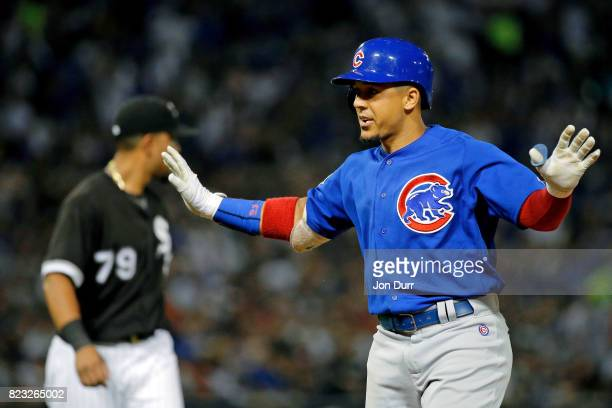 Jon Jay of the Chicago Cubs reacts after hitting an RBI single against the Chicago White Sox to score Ben Zobrist during the fifth inning at...