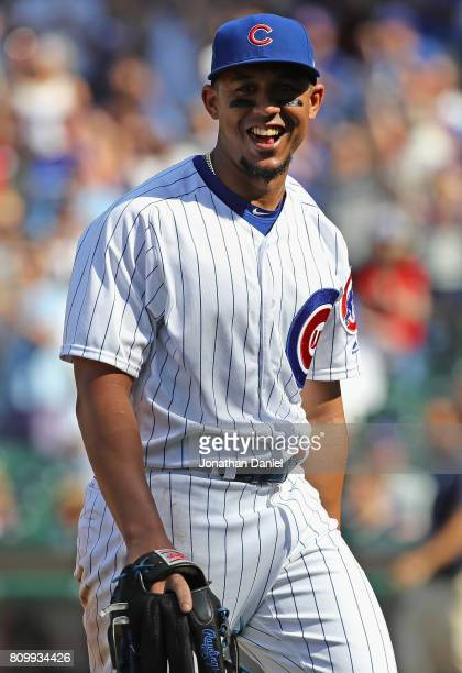 Jon Jay of the Chicago Cubs smiles as he leaves the field after pitching in the 9th inning against the Milwaukee Brewers at Wrigley Field on July 6...