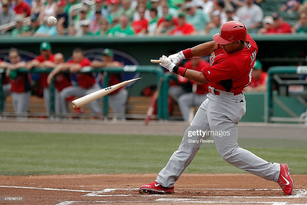 Jon Jay #19 of the St. Louis Cardinals breaks a bat in the first inning of a game against the Boston Red Sox at JetBlue Park at Fenway South on March 17, 2014 in Fort Myers, Florida.