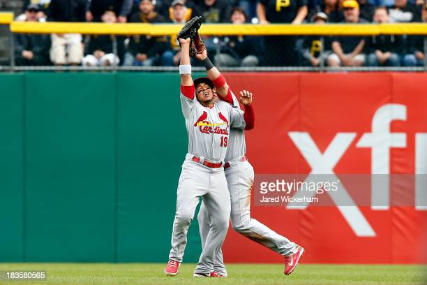 Jon Jay of the St Louis Cardinals catches a fly ball as he collides with Carlos Beltran in the fifth inning hit by Pedro Alvarez of the Pittsburgh...