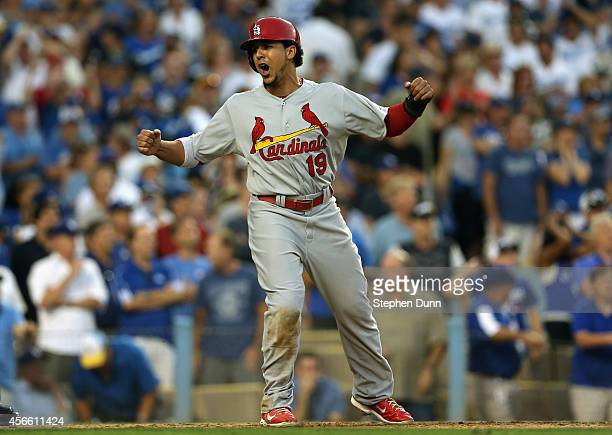 Jon Jay of the St Louis Cardinals celebrates after scoring on teammate's Matt Carpenter RBI double in the seventh inning against the Los Angeles...