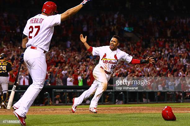 Jon Jay of the St Louis Cardinals celebrates after scoring the gamewinning run against the Pittsburgh Pirates in the tenth inning at Busch Stadium on...