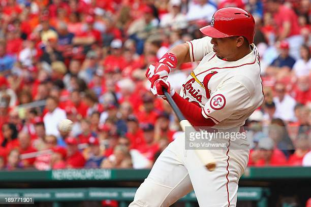 Jon Jay of the St Louis Cardinals hits an RBI single off of starter Matt Cain of the San Francisco Giants in the third inning during game one of a...