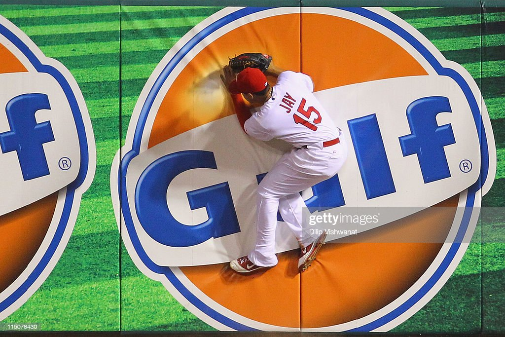 Jon Jay #15 of the St. Louis Cardinals hits the wall chasing down a home run ball against the San Francisco Giants at Busch Stadium on June 2, 2011 in St. Louis, Missouri.