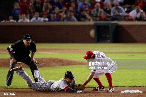 Jon Jay of the St Louis Cardinals is caught stealing at second base by Ian Kinsler of the Texas Rangers as umpire Jerry Layne looks on in the seventh...