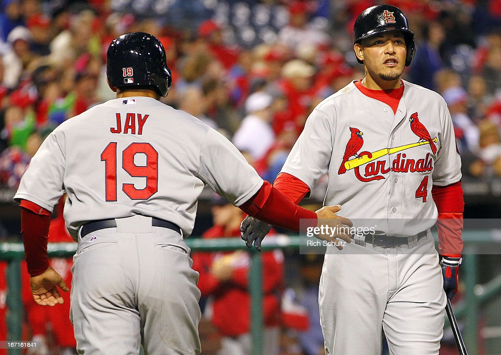 <a gi-track='captionPersonalityLinkClicked' href=/galleries/search?phrase=Jon+Jay+-+Baseball+Player&family=editorial&specificpeople=5734285 ng-click='$event.stopPropagation()'>Jon Jay</a> #19 of the St. Louis Cardinals is congratulated by teammate <a gi-track='captionPersonalityLinkClicked' href=/galleries/search?phrase=Yadier+Molina&family=editorial&specificpeople=172002 ng-click='$event.stopPropagation()'>Yadier Molina</a> #4 after scoring on a single by Allen Craig #21 in the seventh inning against the Philadelphia Phillies in a MLB baseball game on April 21, 2013 at Citizens Bank Park in Philadelphia, Pennsylvania. The Phillies defeated the Cardinals 7-3.