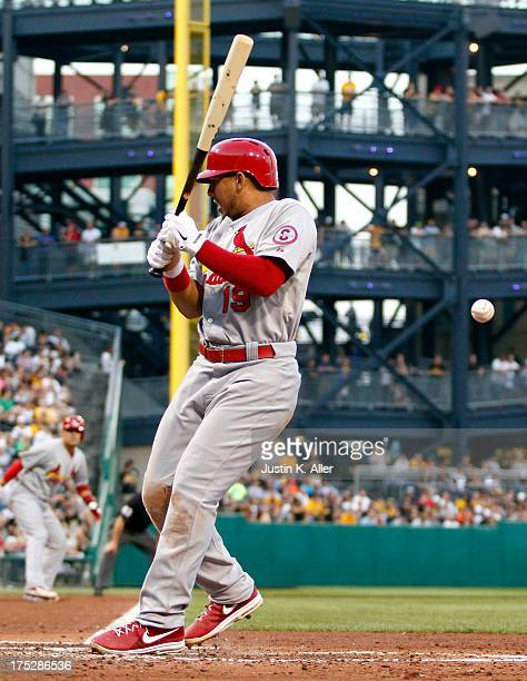 Jon Jay of the St Louis Cardinals is hit by a pitch with the bases load in the fourth inning against the Pittsburgh Pirates during the game on August...