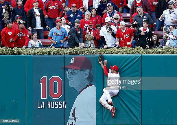 Jon Jay of the St Louis Cardinals makes a catch against the wall on a ball hit by Danny Espinosa of the Washington Nationals in the sixth inning...