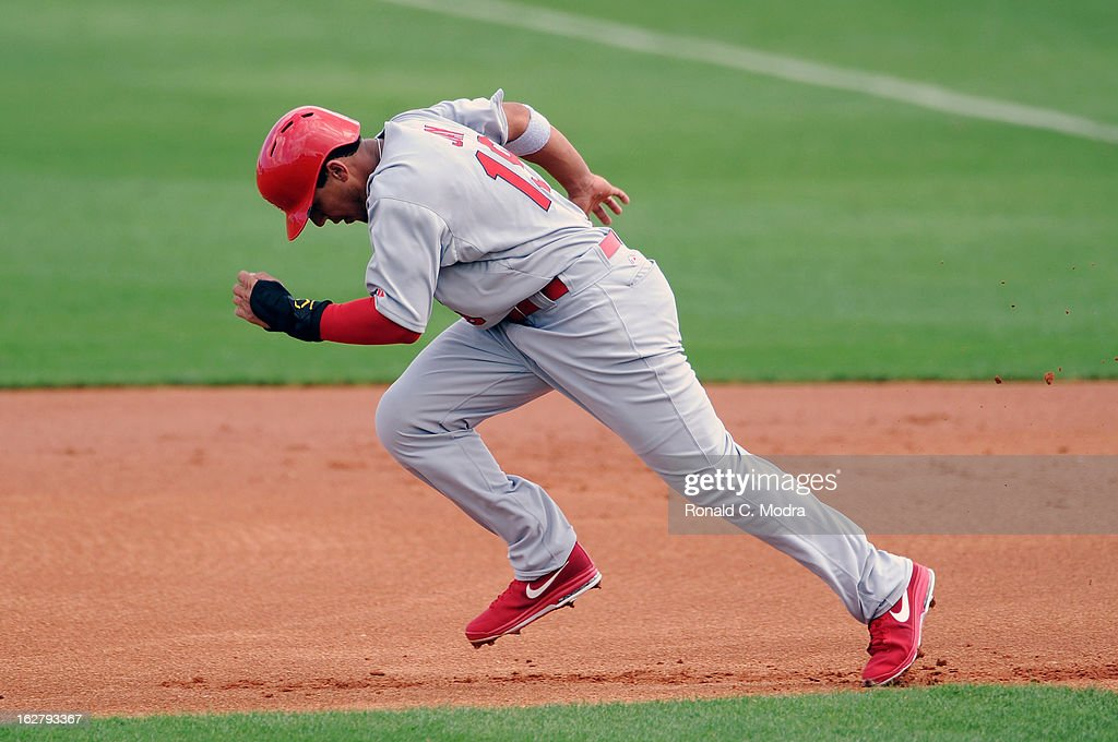 Jon Jay #19 of the St. Louis Cardinals runs to second base during a spring training game against the Florida Marlins at Roger Dean Stadium on February 23, 2013 in Jupiter, Florida.