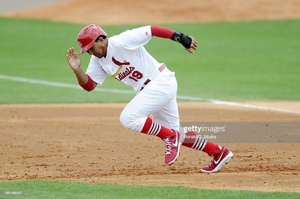 Jon Jay #19 of the St. Louis Cardinals runs to third base during a spring training game against the New York Mets on March 24, 2013 at Roger Dean Stadium in Jupiter, Florida.