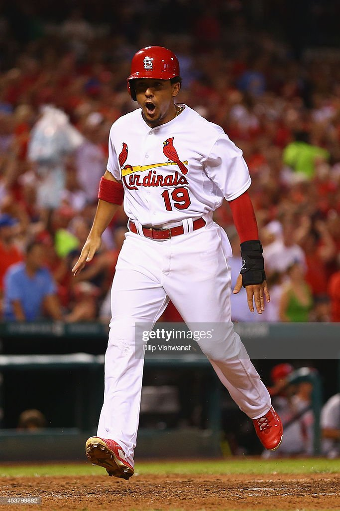 <a gi-track='captionPersonalityLinkClicked' href=/galleries/search?phrase=Jon+Jay+-+Baseball+Player&family=editorial&specificpeople=5734285 ng-click='$event.stopPropagation()'>Jon Jay</a> #19 of the St. Louis Cardinals scores a run against the Cincinnati Reds in the seventh inning at Busch Stadium on August 18, 2014 in St. Louis, Missouri. The Cardinals beat the Reds in 10 innings.