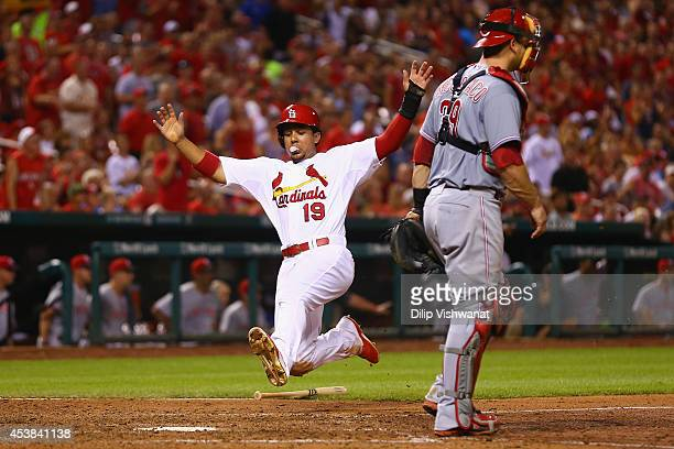 Jon Jay of the St Louis Cardinals scores a run against the Cincinnati Reds in the sixth inning at Busch Stadium on August 19 2014 in St Louis...