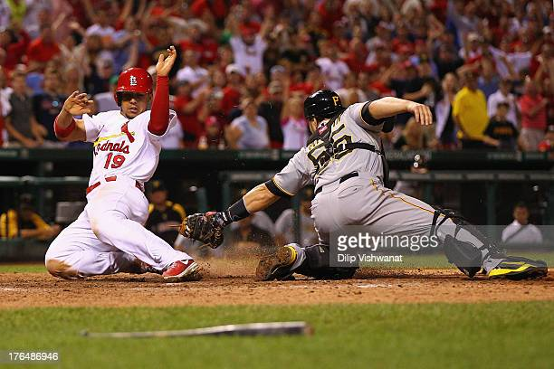 Jon Jay of the St Louis Cardinals scores the gamewinning run against Russell Martin of the Pittsburgh Pirates in the 14th inning at Busch Stadium on...