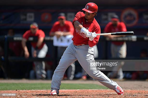 Jon Jay of the St Louis Cardinals swings at a pitch during a spring training game against the New York Mets at Tradition Field on March 20 2015 in...