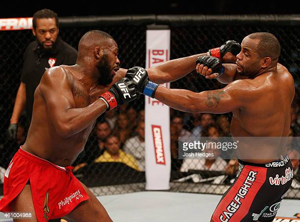 Jon Jones and Daniel Cormier exchange punches in their UFC light heavyweight championship bout during the UFC 182 event at the MGM Grand Garden Arena...