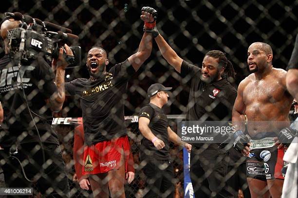 Jon Jones celebrates after defeating Daniel Comier during their light heavyweight title fight at the MGM Grand Garden Arena on January 3 2015 in Las...