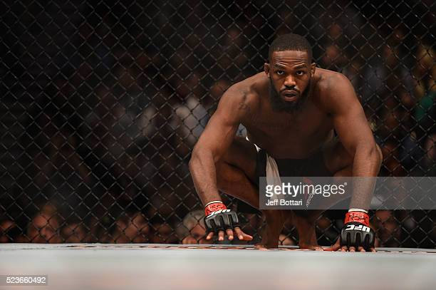 Jon Jones crouches in his corner before facing Ovince Saint Preux in their interim UFC light heavyweight championship bout during the UFC 197 event...