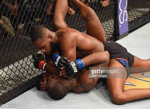 Jon Jones elbows Ovince Saint Preux in their interim UFC light heavyweight championship bout during the UFC 197 event inside MGM Grand Garden Arena...