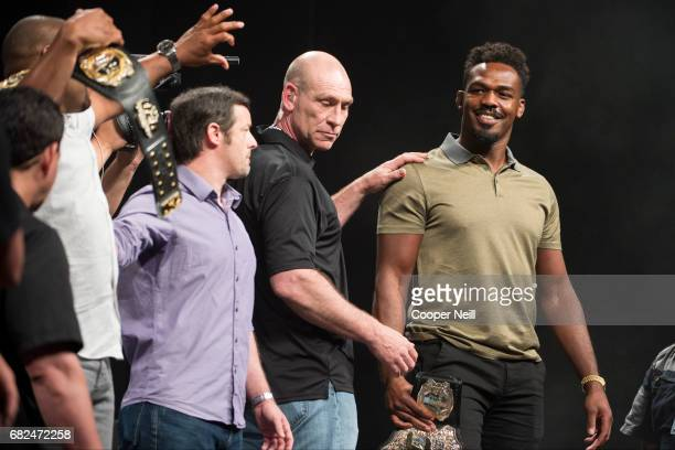 Jon Jones exchanges words with Daniel Cormier during the UFC Summer Kickoff Press Conference at the American Airlines Center on May 12 2017 in Dallas...