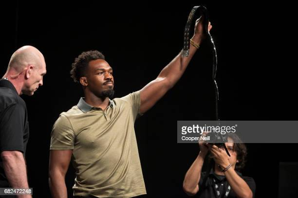 Jon Jones holds a UFC championship belt during the UFC Summer Kickoff Press Conference at the American Airlines Center on May 12 2017 in Dallas Texas