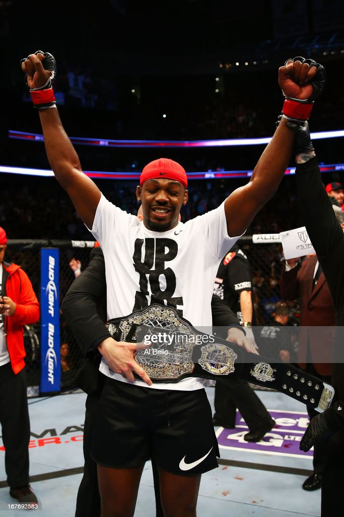 Jon Jones is awarded the championship belt and announced winner by knockout against Chael Sonnen after their light heavyweight championship bout during the UFC 159 event at the Prudential Center on April 27, 2013 in Newark, New Jersey.