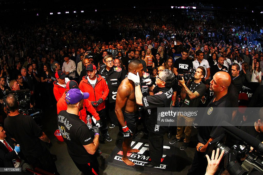 Jon Jones is seen with cutman Jacob 'Stitch' Duran before facing Chael Sonnen in their light heavyweight championship bout during the UFC 159 event at the Prudential Center on April 27, 2013 in Newark, New Jersey.
