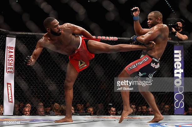Jon Jones kicks Daniel Cormier in their UFC light heavyweight championship bout during the UFC 182 event at the MGM Grand Garden Arena on January 3...