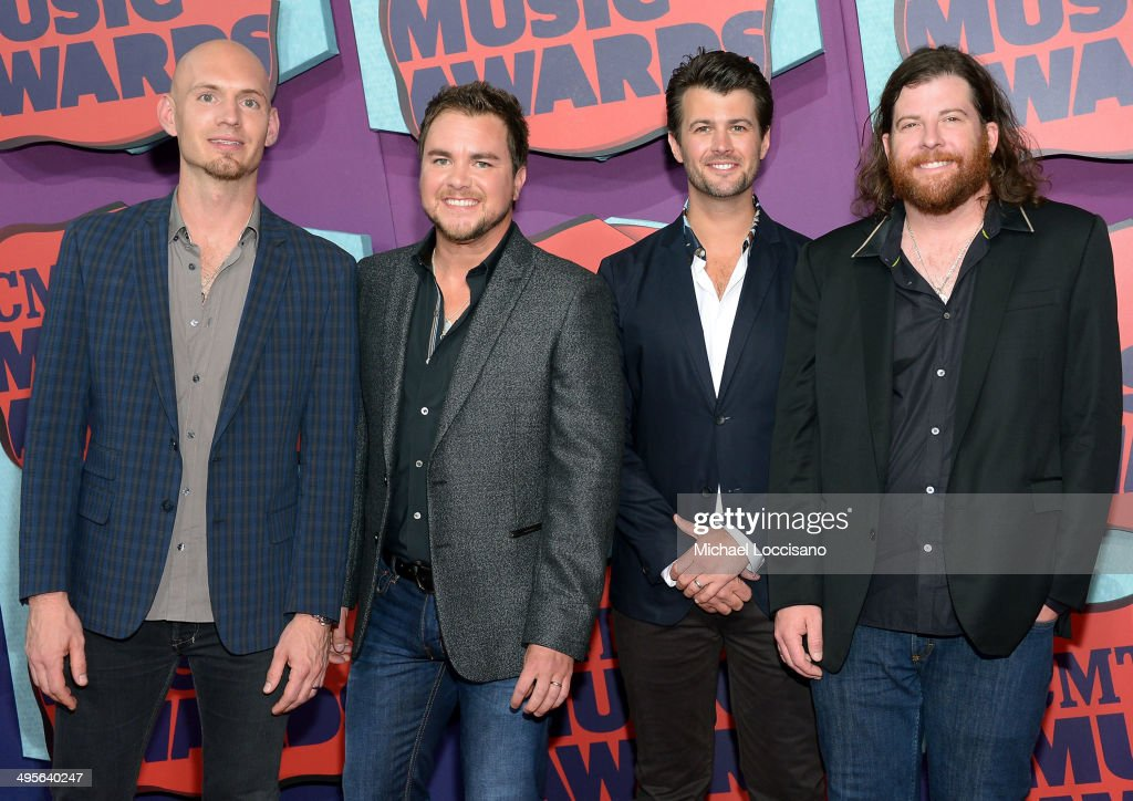 Jon Jones, Mike Eli, Chris Thompson and James Young of the Eli Young Band attend the 2014 CMT Music awards at the Bridgestone Arena on June 4, 2014 in Nashville, Tennessee.