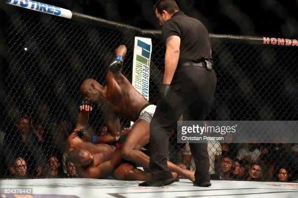 Jon Jones punches Daniel Cormier in their UFC light heavyweight championship bout during the UFC 214 event at Honda Center on July 29 2017 in Anaheim...