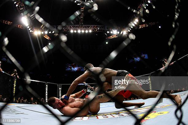 Jon Jones punches Mauricio 'Shogun' Rua on the ground during their light heavyweight championship bout at UFC 128 at the Prudential Center on March...