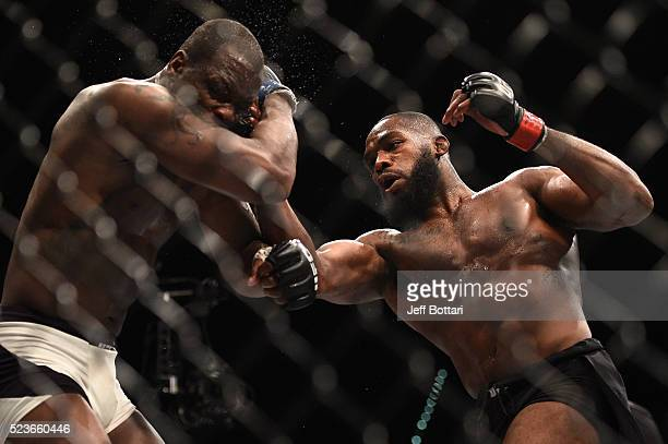 Jon Jones punches Ovince Saint Preux in their interim UFC light heavyweight championship bout during the UFC 197 event inside MGM Grand Garden Arena...