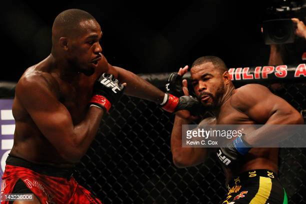 Jon Jones punches Rashad Evans during their light heavyweight title bout for UFC 145 at Philips Arena on April 21 2012 in Atlanta Georgia