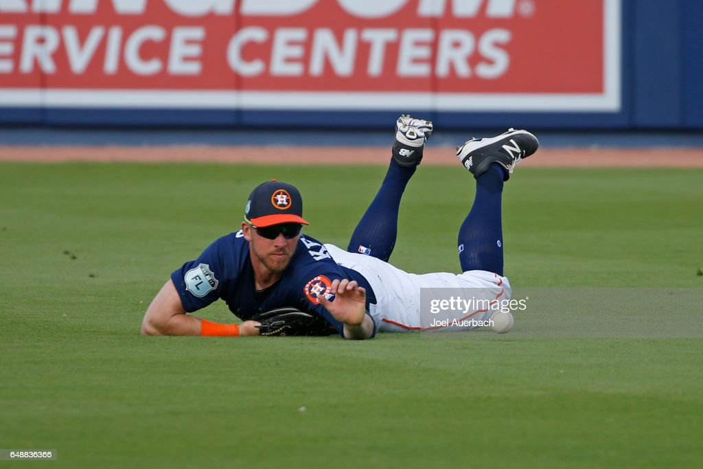 Jon Kemmer #75 of the Houston Astros is unable to catch the ball hit by Jake DePew #77 of the Boston Red Sox in the ninth inning during a spring training game at The Ballpark of the Palm Beaches on March 6, 2017 in West Palm Beach, Florida. The Astros and Red Sox played to a 5-5 tie.
