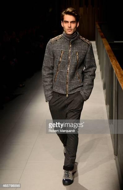 Jon Kortajarena walks the runway for the Custo Barcelona fashion show during 080 Barcelona Fashion AutumnWinter 20142015 on January 29 2014 in...