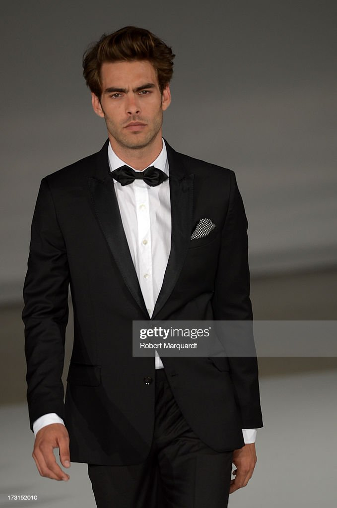 <a gi-track='captionPersonalityLinkClicked' href=/galleries/search?phrase=Jon+Kortajarena&family=editorial&specificpeople=4684429 ng-click='$event.stopPropagation()'>Jon Kortajarena</a> walks the runway for the latest collection by MANGO held at the Disseny Hub Barcelona on July 8, 2013 in Barcelona, Spain.
