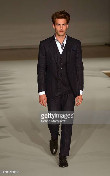 Jon Kortajarena walks the runway for the latest collection by MANGO held at the Disseny Hub Barcelona on July 8 2013 in Barcelona Spain