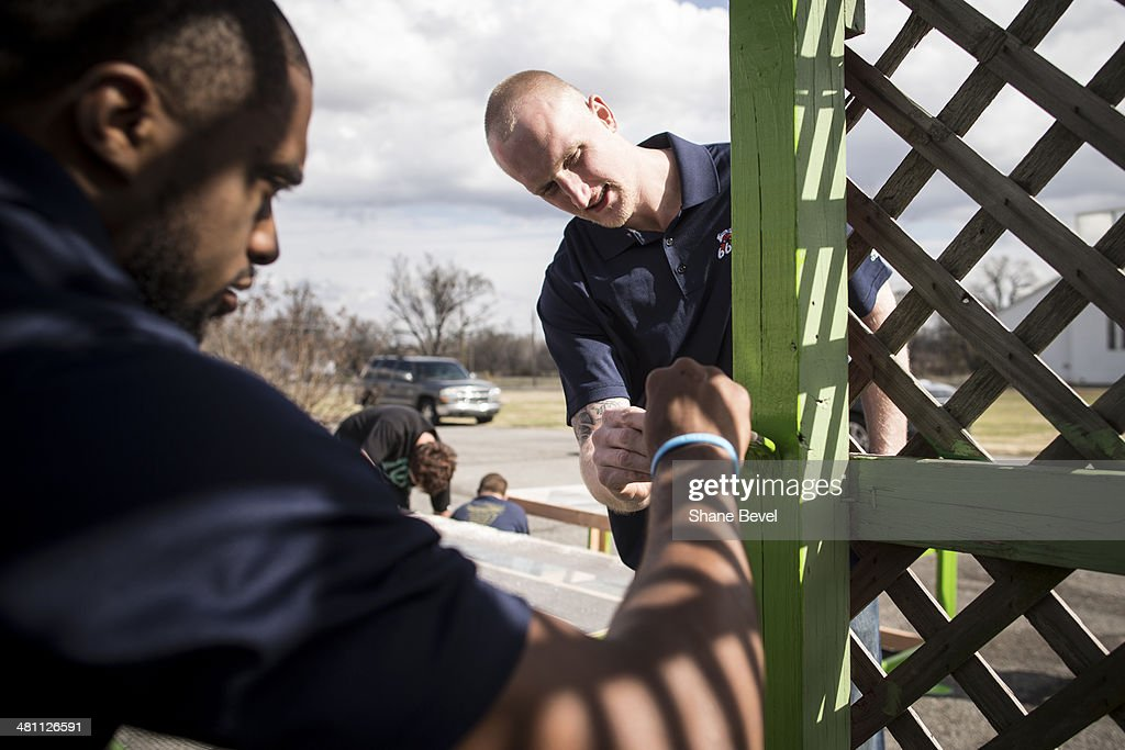 Jon Kreft and Isaiah Wilkerson of the Tulsa 66ers paint a pergola during the NBA D-League community relations event at A New Leaf, a non-profit that employs adults with developmental disabilities, on March 27, 2014 in Broken Arrow, Oklahoma.